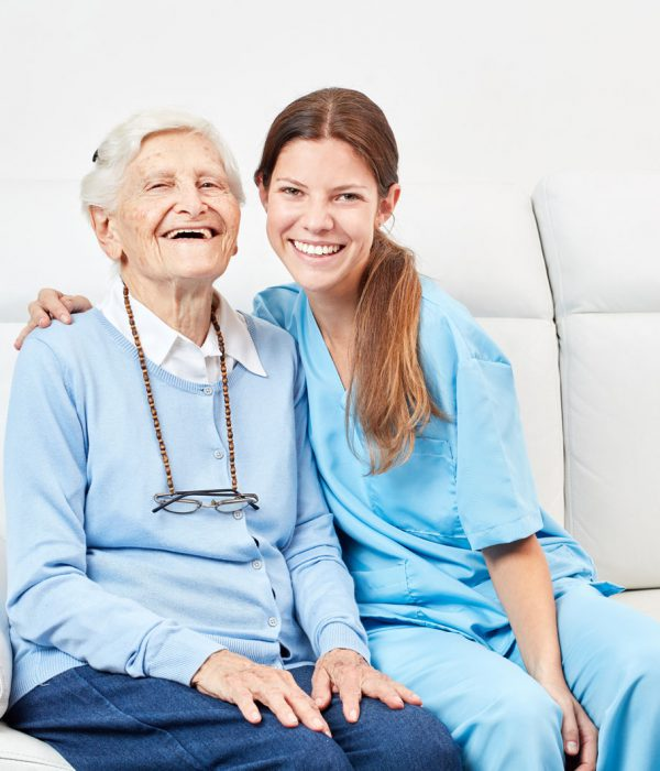 bigstock-Smiling-nursing-assistant-and--222592471
